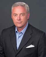 Rick Looser, President & COO