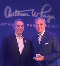 Roger Bolton, president of the Arthur W. Page Society, congratulates Looser.